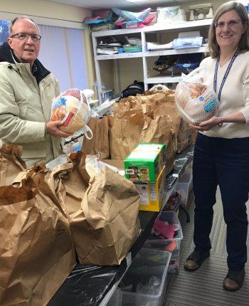 image of volunteers working on Thanksgiving baskets