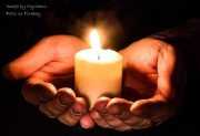 Image of hands holding candle